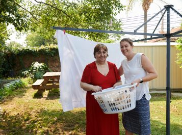 two women and laundry basket
